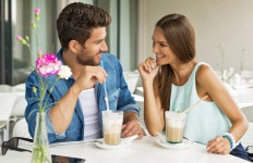 Smiling couple in cafe enjoying the time spending with each other