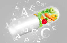 Different fruit and vegetables in capsule - healthy diet or natural vitamins concept