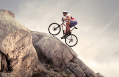 Cyclist riding a mountain bike on some rocks