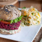 Vegan  burgers with black bean and beetroot patties, buckwheat buns and cashew nuts sauce