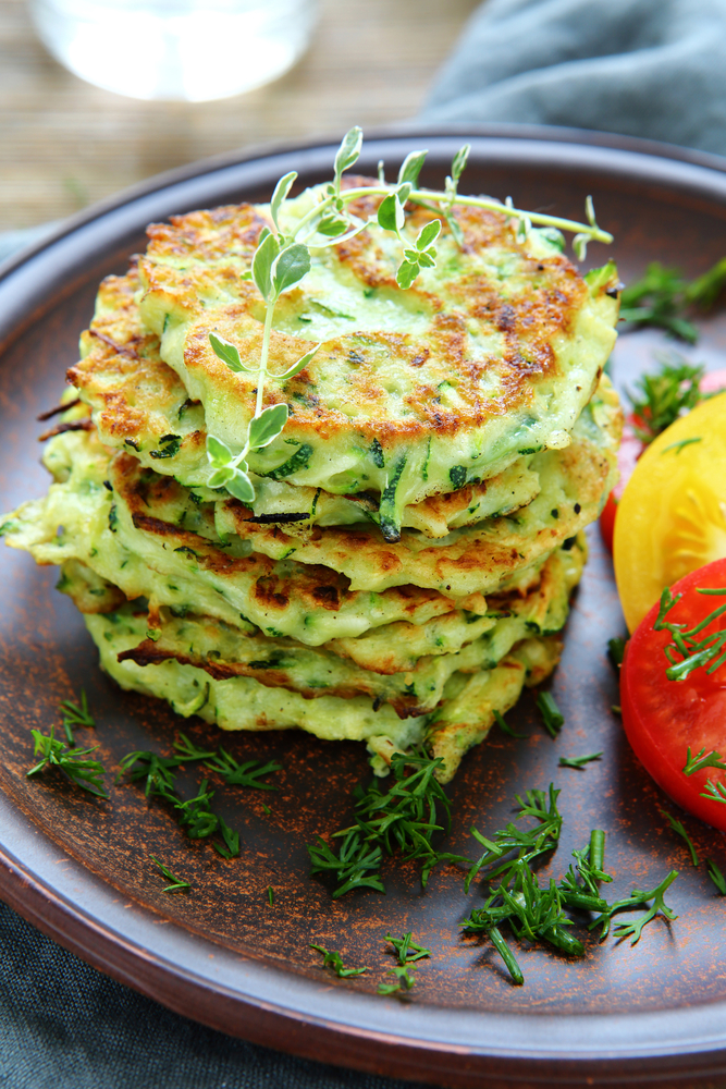 pancakes with zucchini and herbs, food closeup