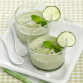 Cucumber gazpacho with mint in glass cups on a white plate