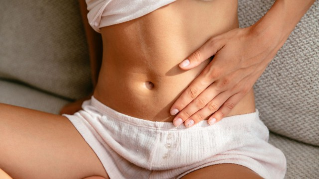 Woman having Stomach Pain at home